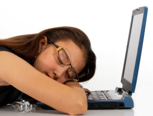 Girl Asleep On Her Notebook Computer